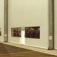 windows fixed into hangar doors